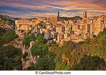 Sorano, Grosseto, Tuscany, Italy: landscape at the sunset of the picturesque medieval village on the hill