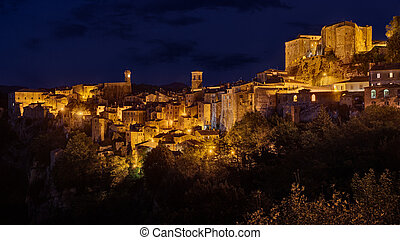 Sorano, Grosseto, Tuscany, Italy: night landscape of the picturesque medieval village on the hill