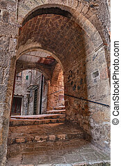 Sorano, Grosseto, Tuscany, Italy: picturesque old narrow alley with dark underpass in the medieval town