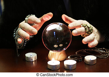 sorcerer hands over a transparent crystal ball...