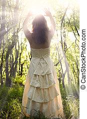 Sorceress - Beautiful young woman wearing elegant white...