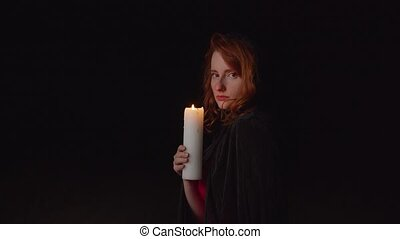 Sorceress putting out candle outdoor at night - Attractive ...