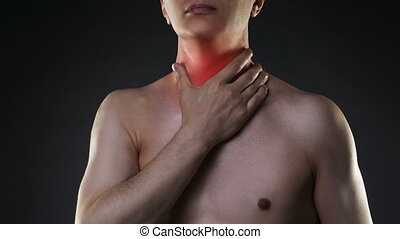 Sore throat, men with pain in neck, black background, studio...