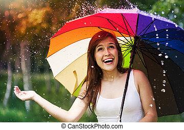 sorprendido, mujer con paraguas, durante, verano, lluvia