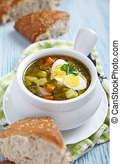 Sorrel soup with quail eggs
