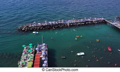 Sorrento, southern Italy - beach of Sorrento at summer day,...