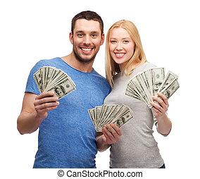 sorridente, coppia, presa a terra, dollaro, contanti, soldi