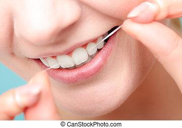 sorridente, donna, dentale, filo seta