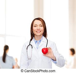 sorridente, dottore femmina, con, cuore, e, stetoscopio
