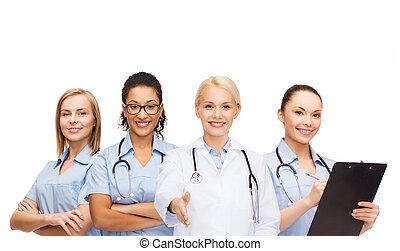 sorridente, dottore femmina, e, infermiere, con, stetoscopio
