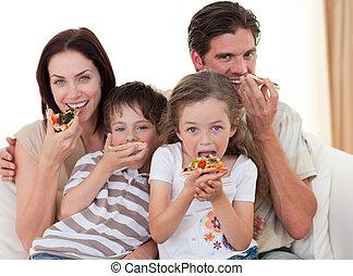 sorridente, pizza, famiglia mangiando
