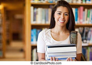 sorrindo, estudante, segurando, livros