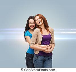 sorrindo, meninas, adolescente, abraçando