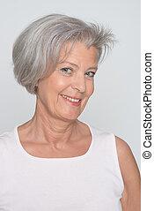 sorrindo, mulher idosa