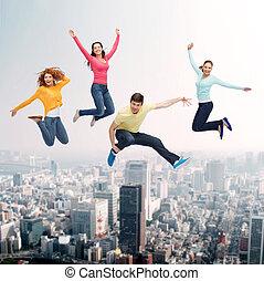 sorrindo, pular, grupo, adolescentes, ar