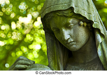 Sorrow - detail of an old marble tombstone at the old ...