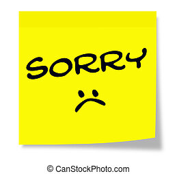 Sorry Sad Face written on a yellow square paper Sticky Note.