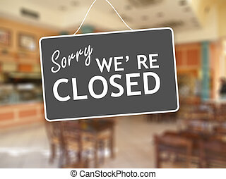 Sorry we are closed sign on glass storefront