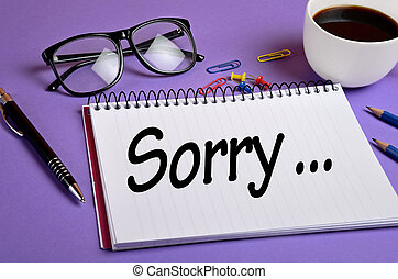 Sorry word on notepad - Sorry word written on notepad