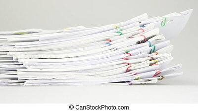 Sort pile of paper of report and paperwork place on table time lapse.