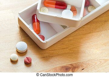 Sorting pills in pillbox for daily use