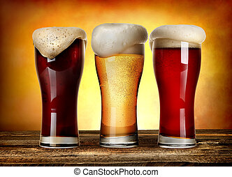 Sorts of beer - Three glasses of beer on a wooden table