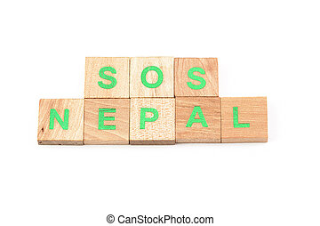 sos nepal written with scrabble letters