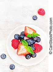 souffle cake with fresh raspberries, blueberries and...
