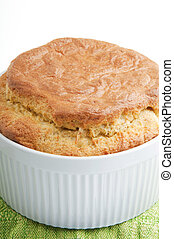 Souffle - Fluffy cheese souffle in white ceramic dish on...