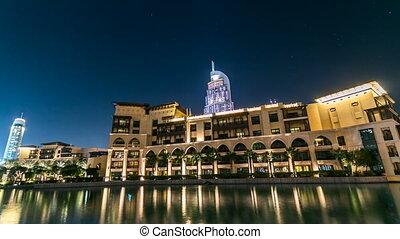Souk and hotel near Burj Khalifa the tallest building in the world timelapse in Dubai, UAE