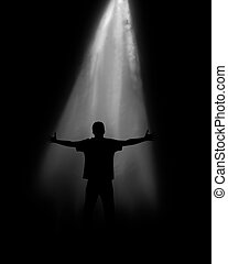 Soul of the person on a black background under light