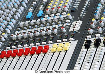 sound board mixer focus red slider - closeup sound board...