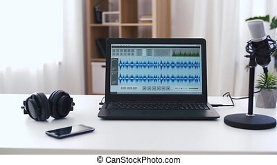 sound editor program on laptop at home office - post ...