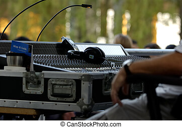 Sound engineer sitting in front of console