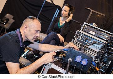 sound engineers preparing material