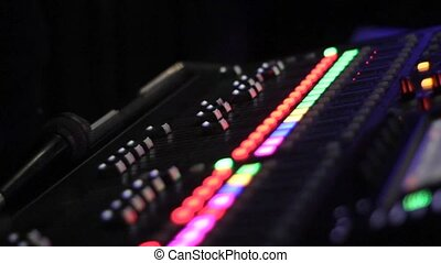sound mixer control panel. focus transference close-up