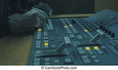 Sound recording studio. Man's' hand writing something, 4K