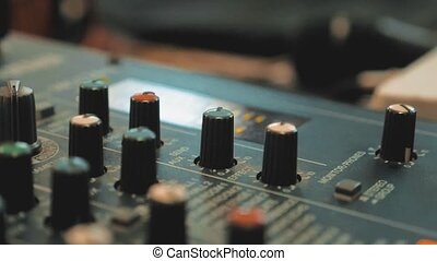 Sound recording studio mixing desk with engineer or music...