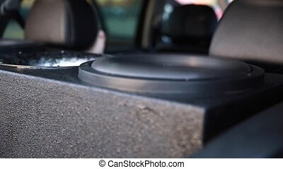 Sound Systems in Car.Vibration sound speaker close-up. Cool sound waves.