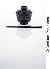 Miso soup bowl with chopstick on white background