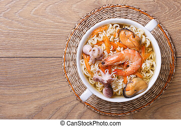 Soup from seafood with the Chinese noodles. top view - Soup...