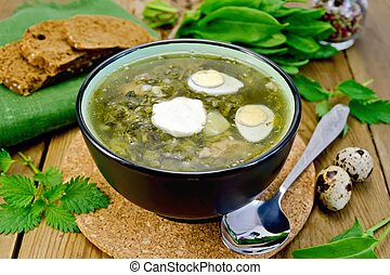 Soup green of sorrel and nettle with quail eggs