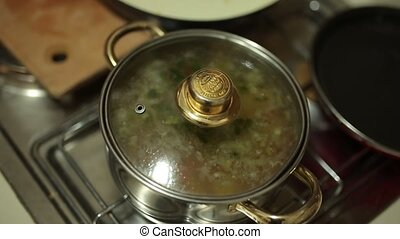 Soup in a pot on the stove. Cooking food