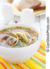 soup with meat in a white tureen