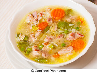 soup with meat, vegetables and rice