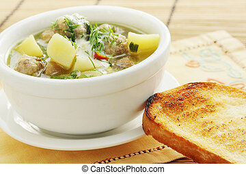 Soup with pork meatballs and crouton