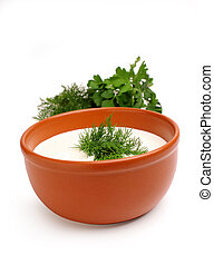 Sour cream and dill in a bowl