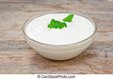 sour cream in a glass bowl - sour cream in a glass bowl