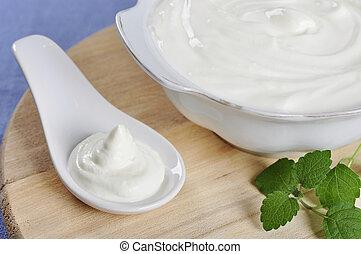 Sour cream in spoon