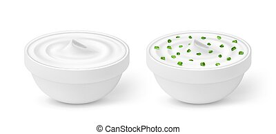 Sour cream with green onion in a bowl isolated on white background
